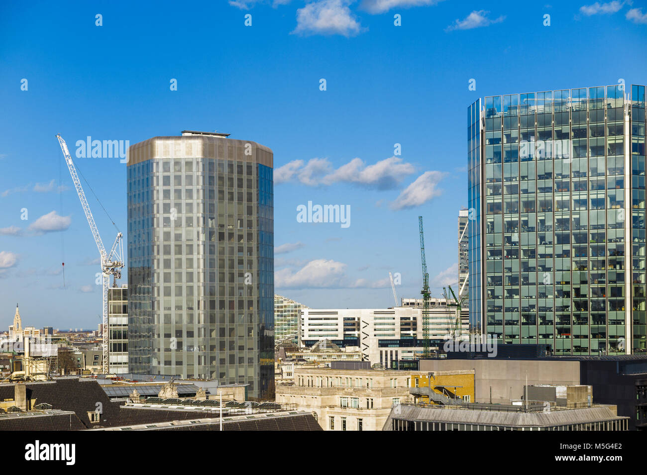Angel Court in the City of London Bank Conservation Area and Stock Exchange Tower, EC2, London's financial district Stock Photo