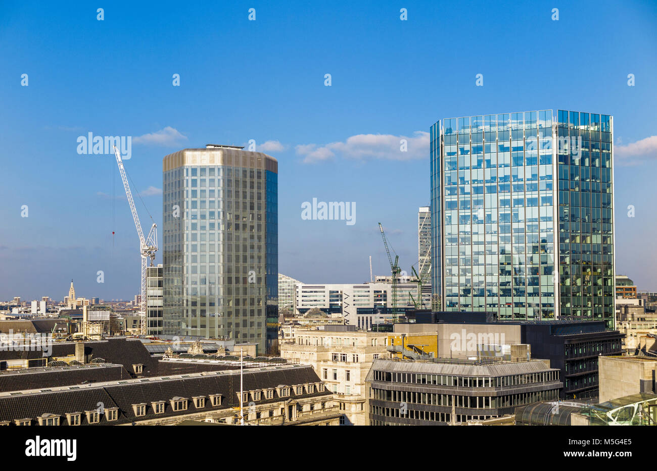 Angel Court in the City of London Bank Conservation Area and Stock Exchange Tower, EC2, London's financial district - Stock Image