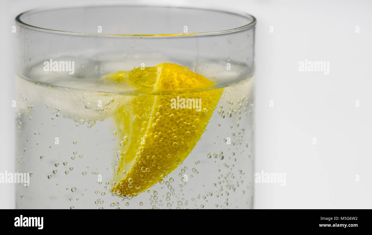Close-up of a gin and tonic in a glass tumbler - Stock Image
