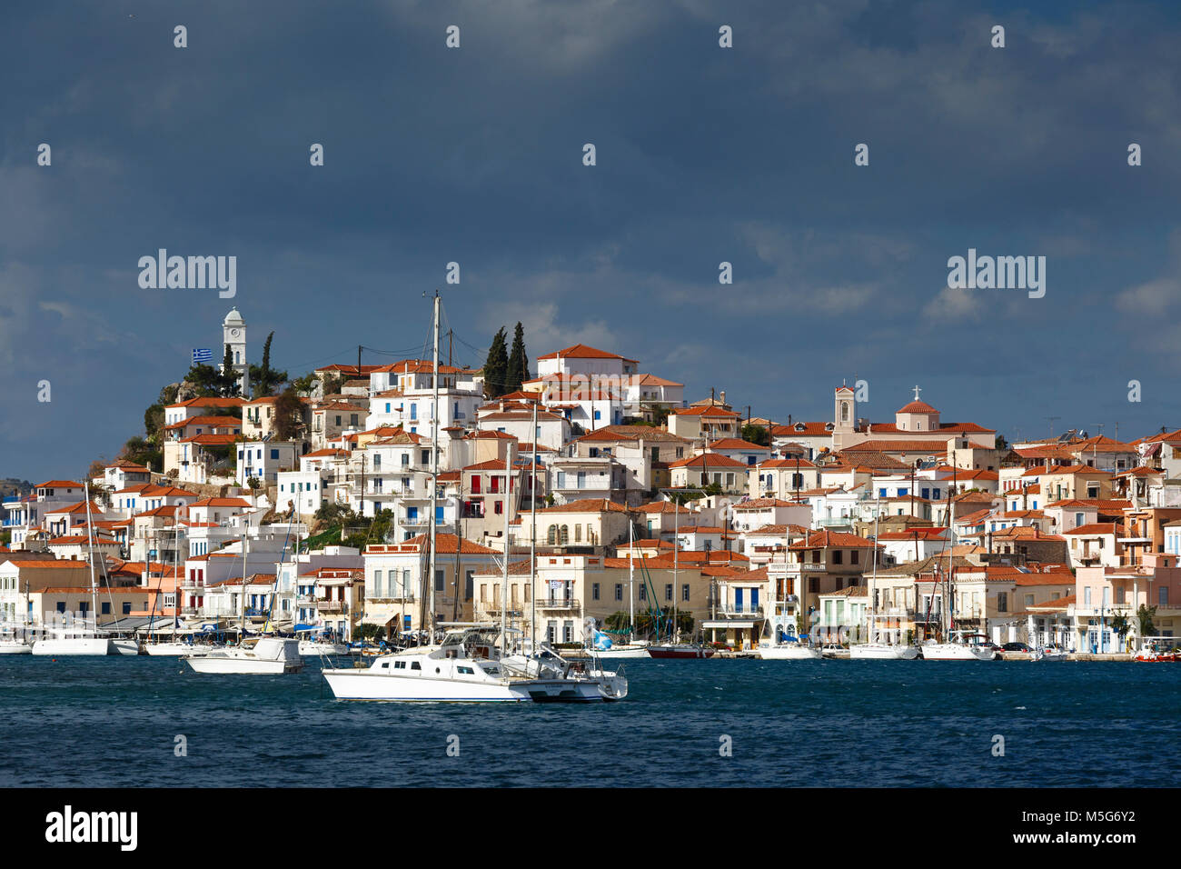 View of the Chora village of Poros island over the sea, Greece. Stock Photo