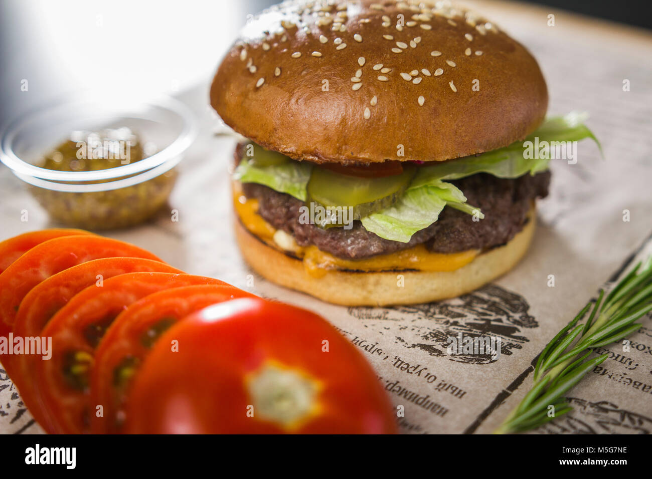 Big tasty burger on the table - Stock Image