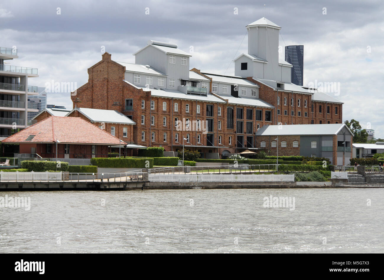 Factory along the Brisbane River, Australia - Stock Image