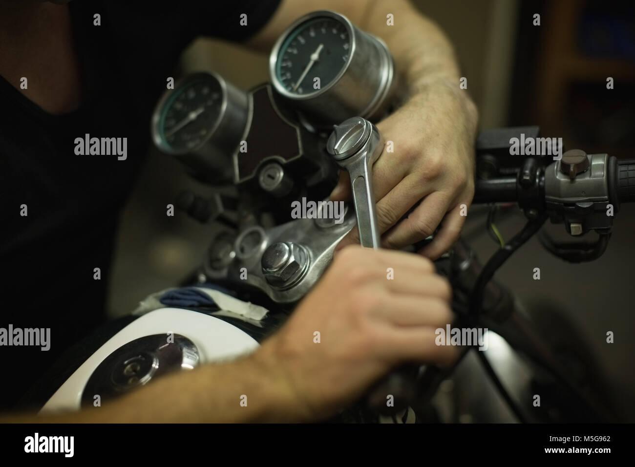 Mechanic tightening motorbike bike handle - Stock Image