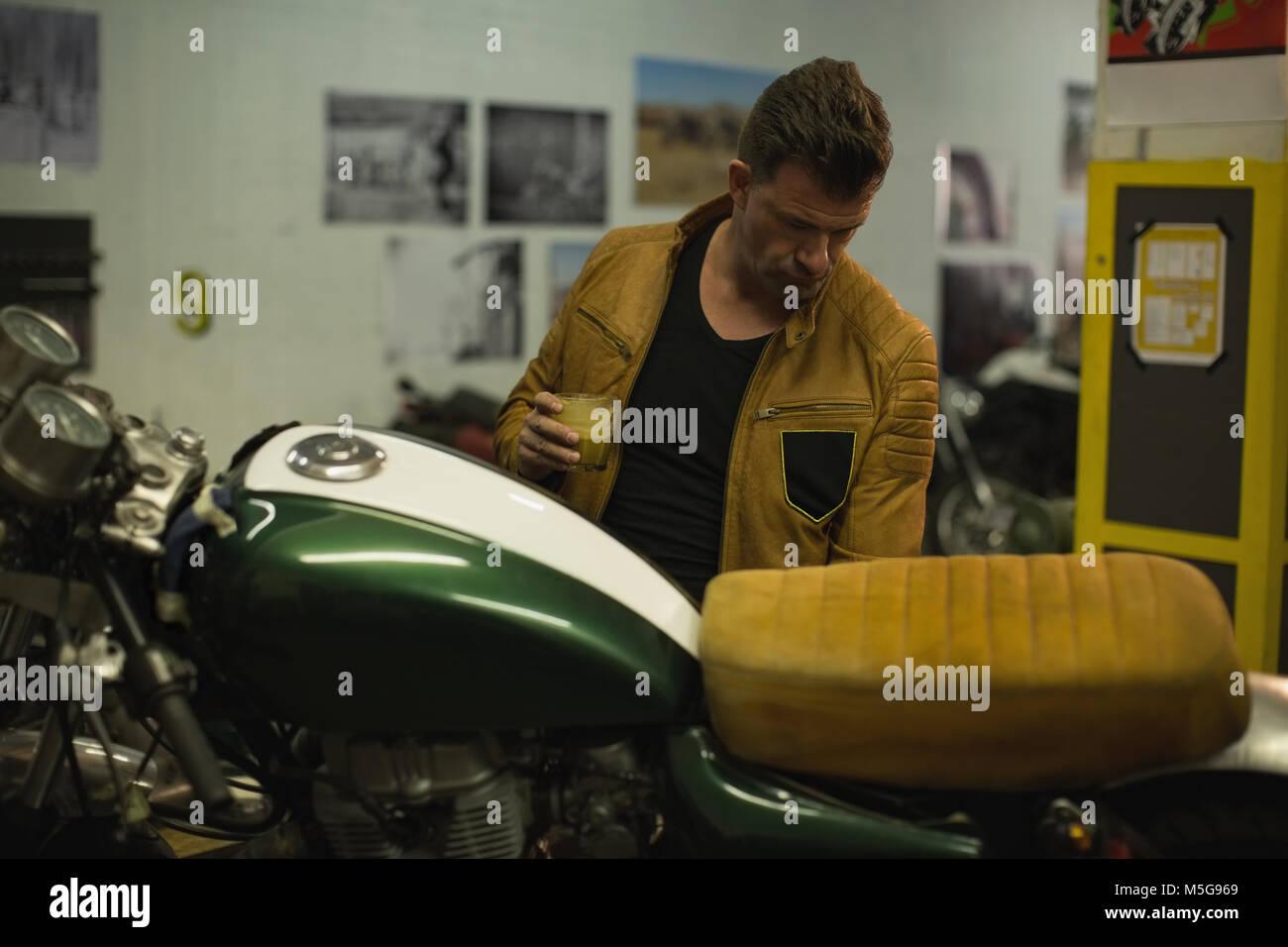Mechanic repairing motorbike - Stock Image