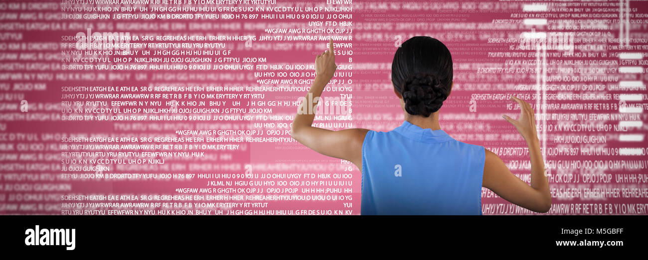 Composite image of rear view of businesswoman touching interface while holding something - Stock Image