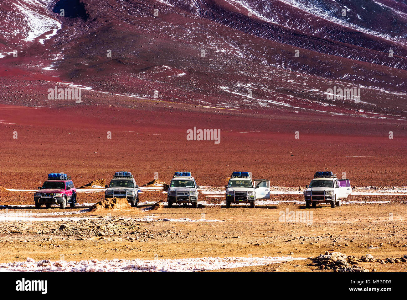 View on Uyuni tour cars in the Altiplano of Bolivia Stock Photo