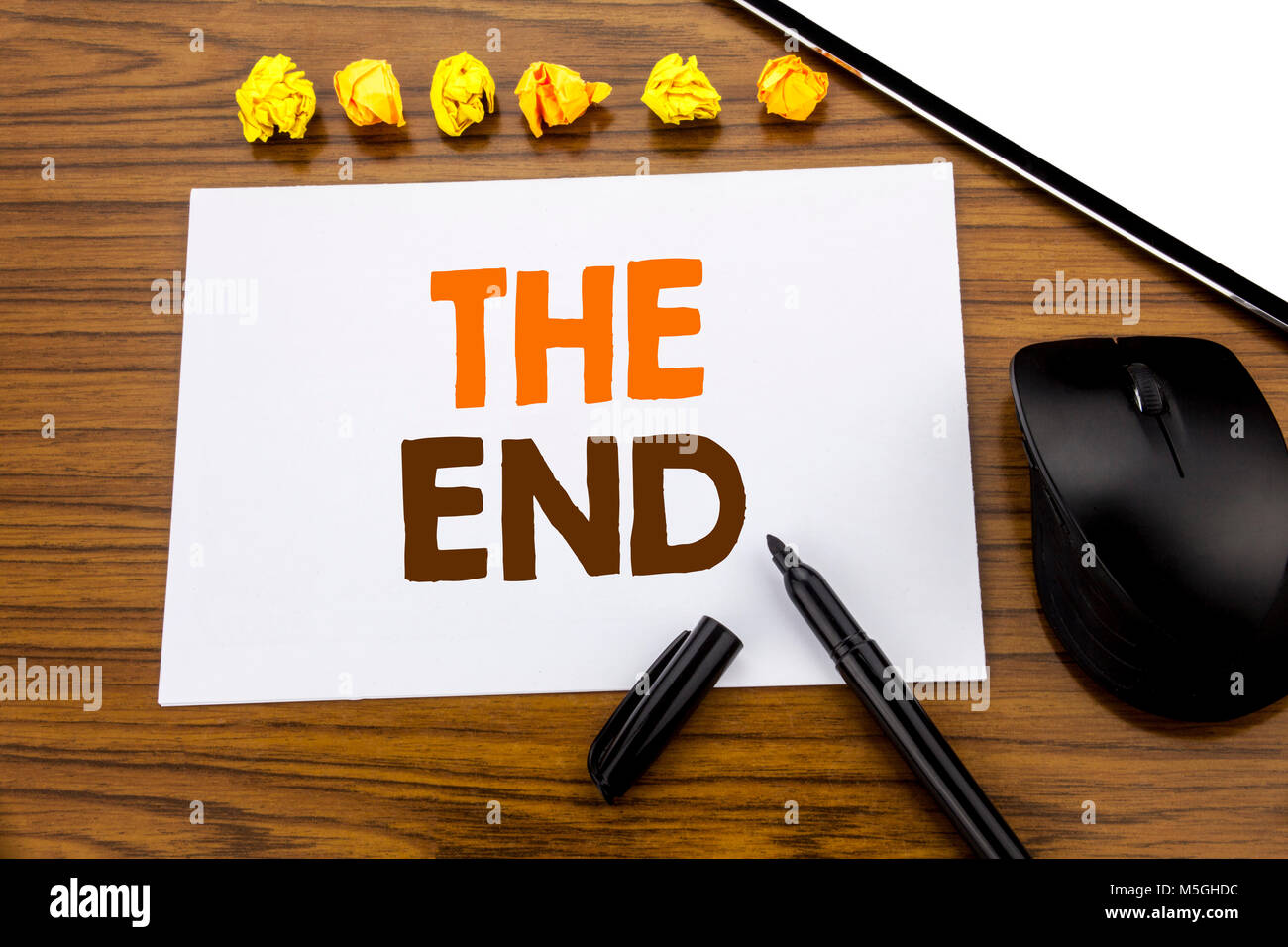 Conceptual hand writing text showing The End. Business concept for End Finish Close written on sticky note paper - Stock Image