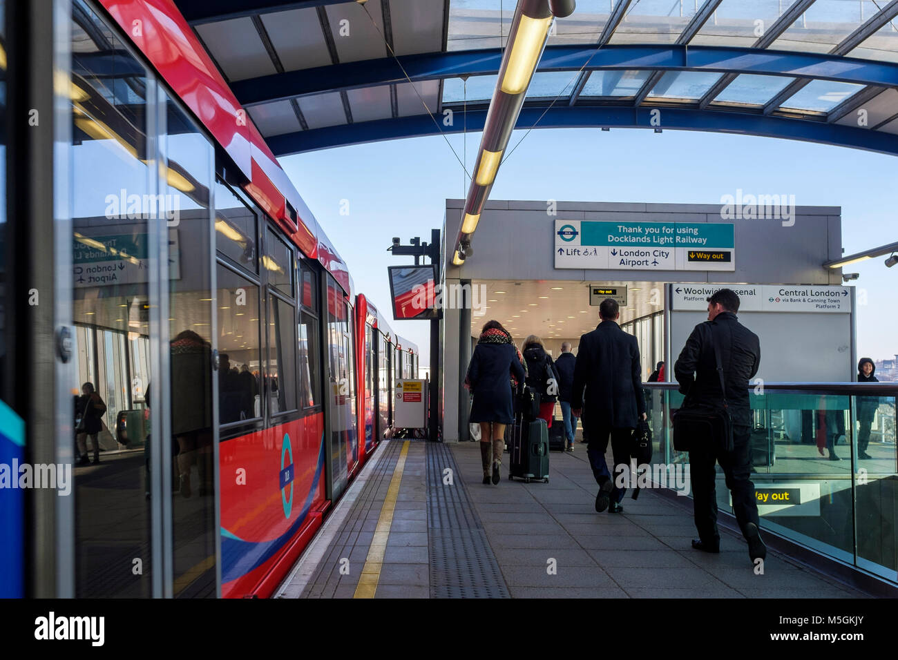 London Docklands Light Railway: Passengers disembarking at London City Airport station. - Stock Image