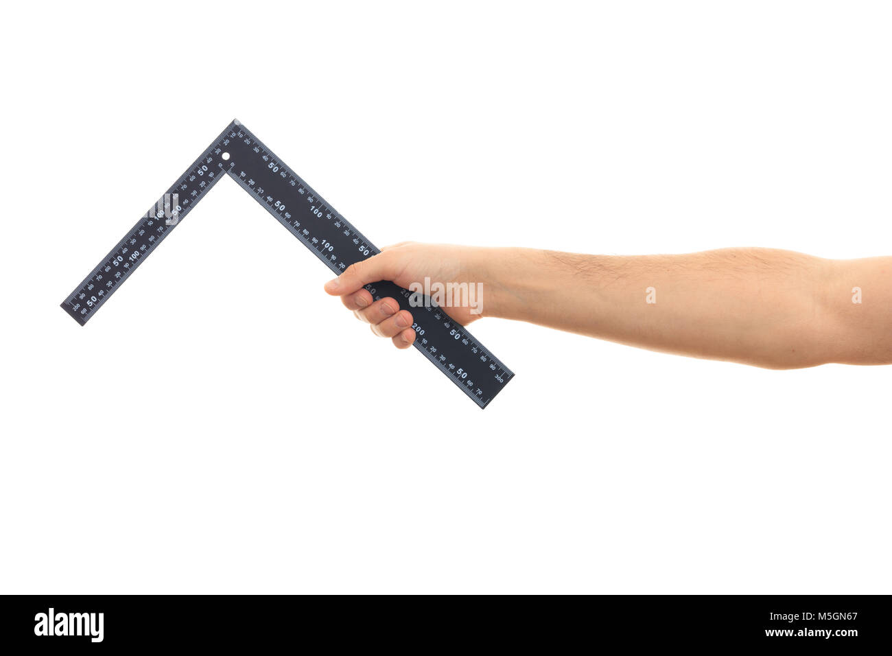 Carpenter ruler L shape. Hand holding an angle square ruler on white background Stock Photo