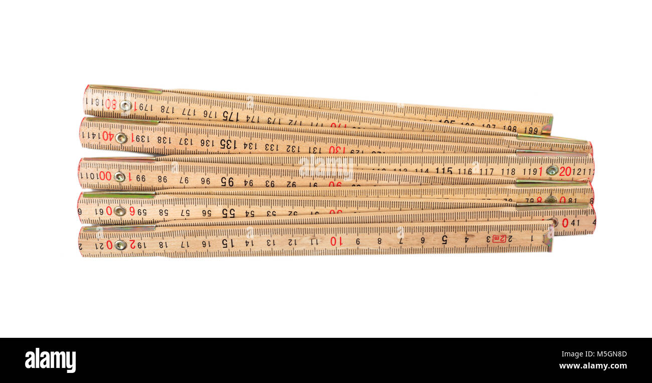 Wooden foldable meter isolated on white background, top view - Stock Image