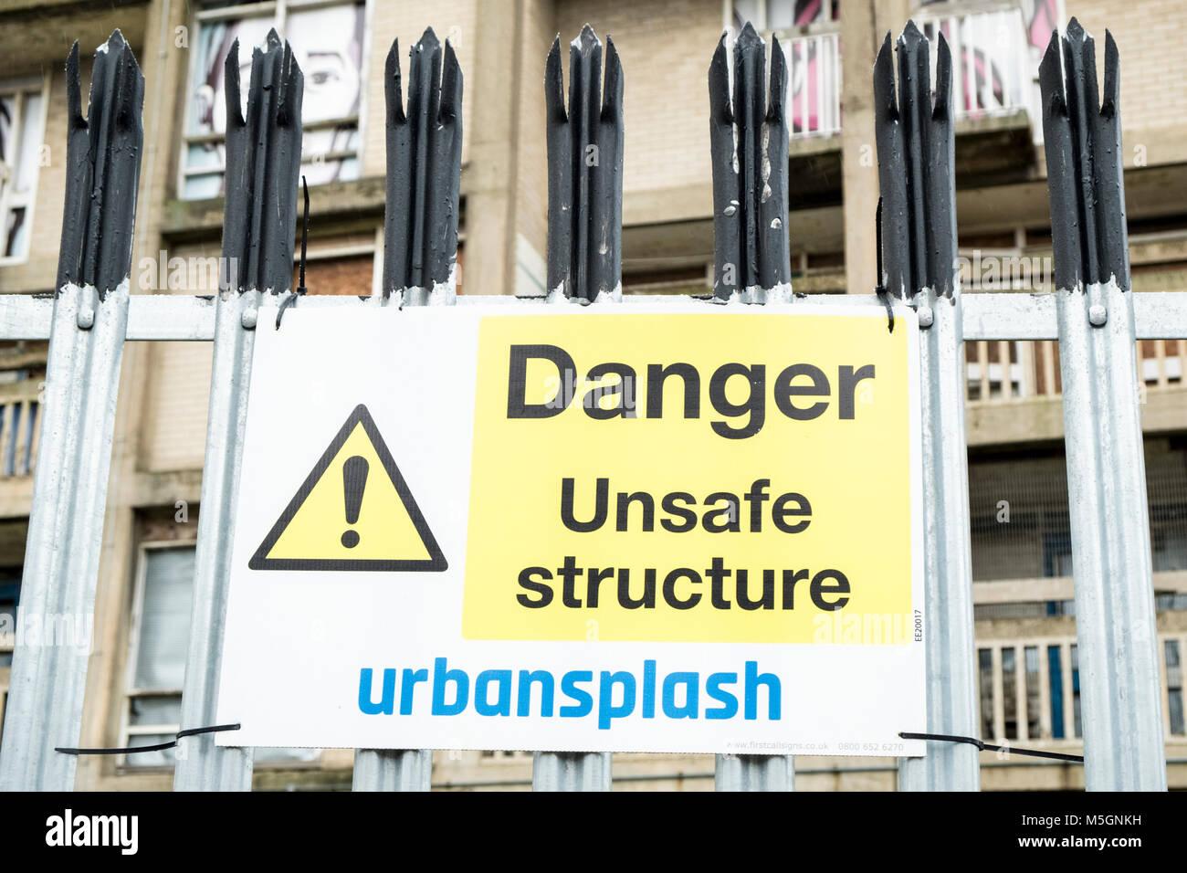 Danger, unsafe structure sign by Urban Splash on security fencing, Park Hill, Sheffield, England, UK.   Urban Splash - Stock Image
