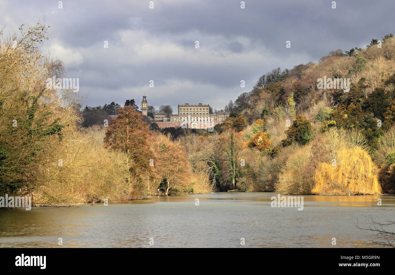 The River Thames in Winter with a Stately Home amidst the trees - Stock Image