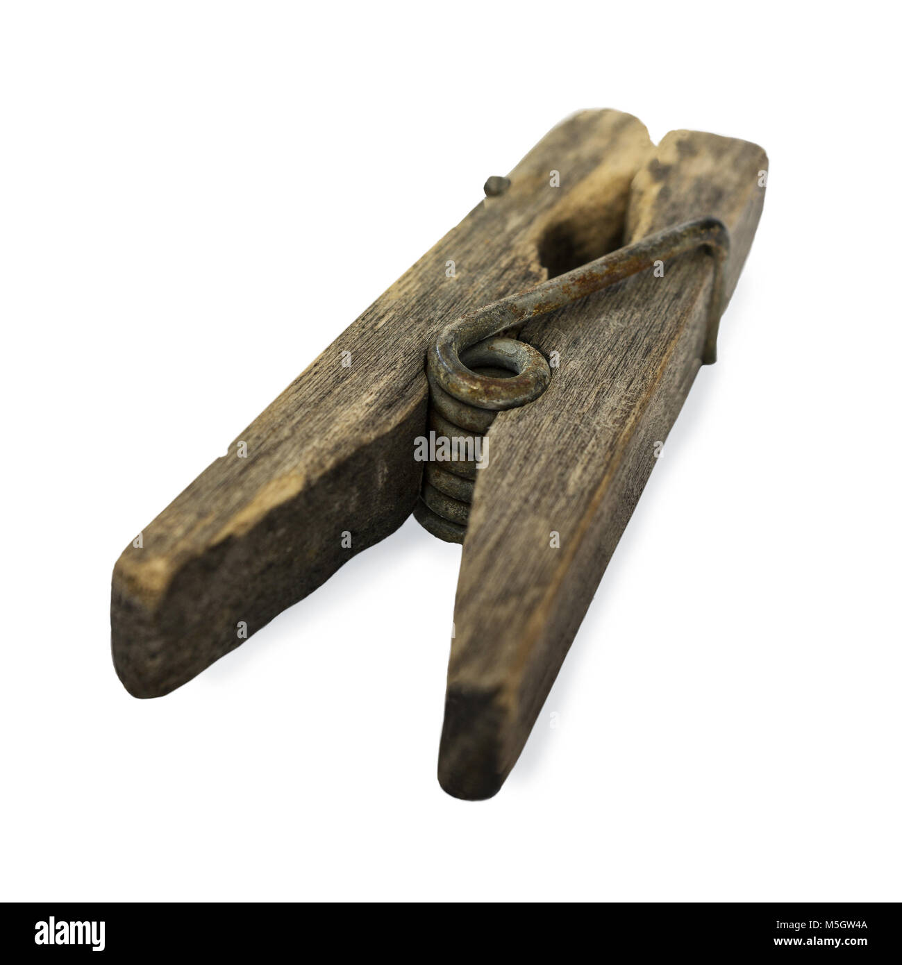 Ramshackle wooden clothespin on a white background - Stock Image