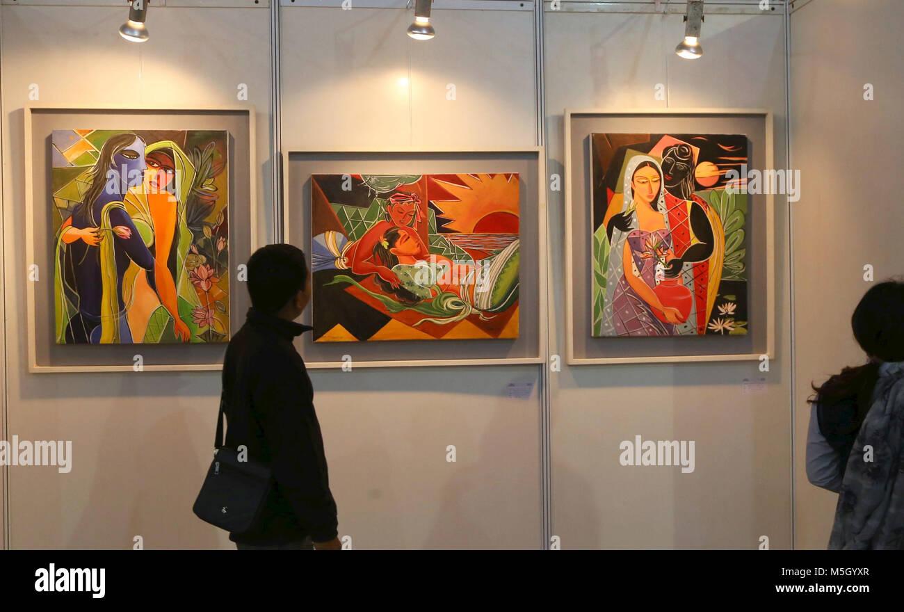 Kathmandu, Nepal. 23rd Feb, 2018. Visitors look at the exhibited drawings at a stall of the 4th Bangladesh Expo - Stock Image