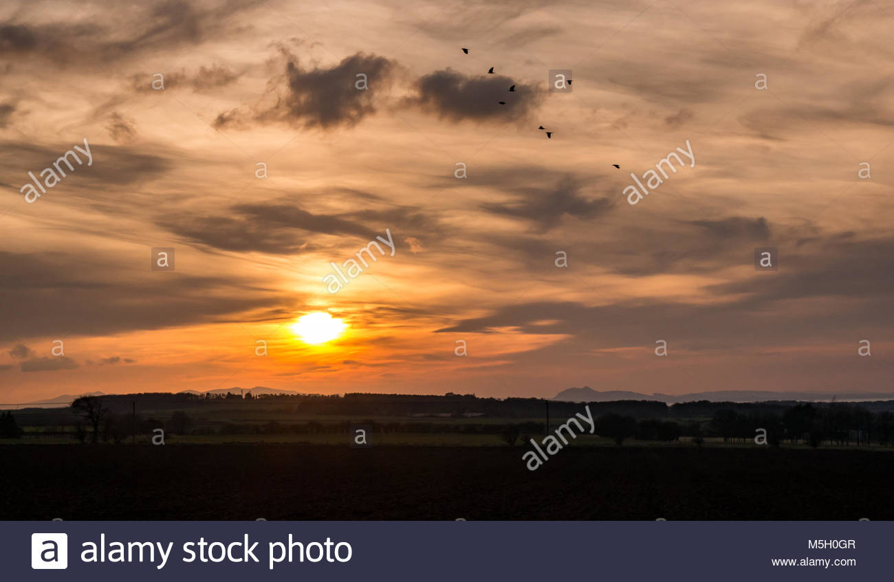 East Lothian, Scotland, 23rd February 2018. UK Weather: Dramatic sunset with wispy cloud formations. The view is Stock Photo