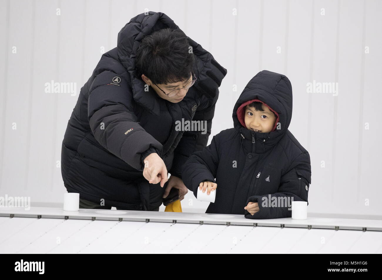 PYEONGCHANG, SOUTH KOREA - FEBRUARY 23, 2018: People look at hydrophobic surface inside a pavilion, nicknamed the - Stock Image
