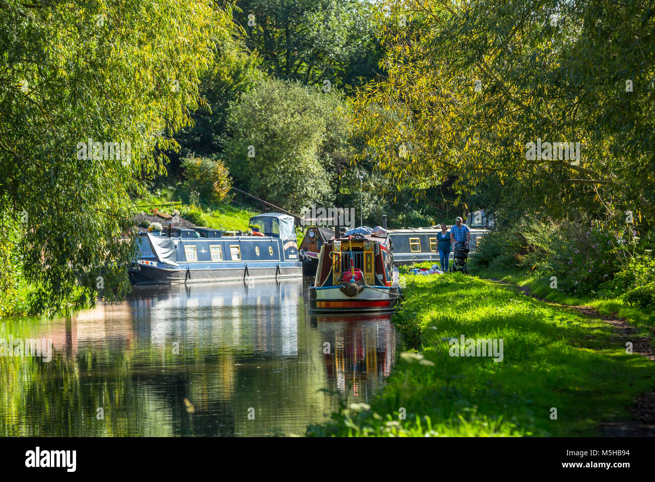 Moored Canal narrow boats on the Staffordshire & Worcestershire Canal at Greensforge. Stock Photo