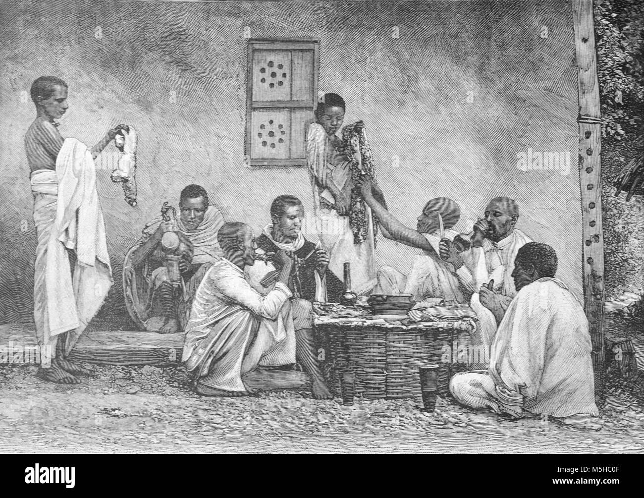 An Ethiopian Family Sits Down to a Meal or Feast in Abyssinia or Ethiopia (Engraving, 1889) - Stock Image