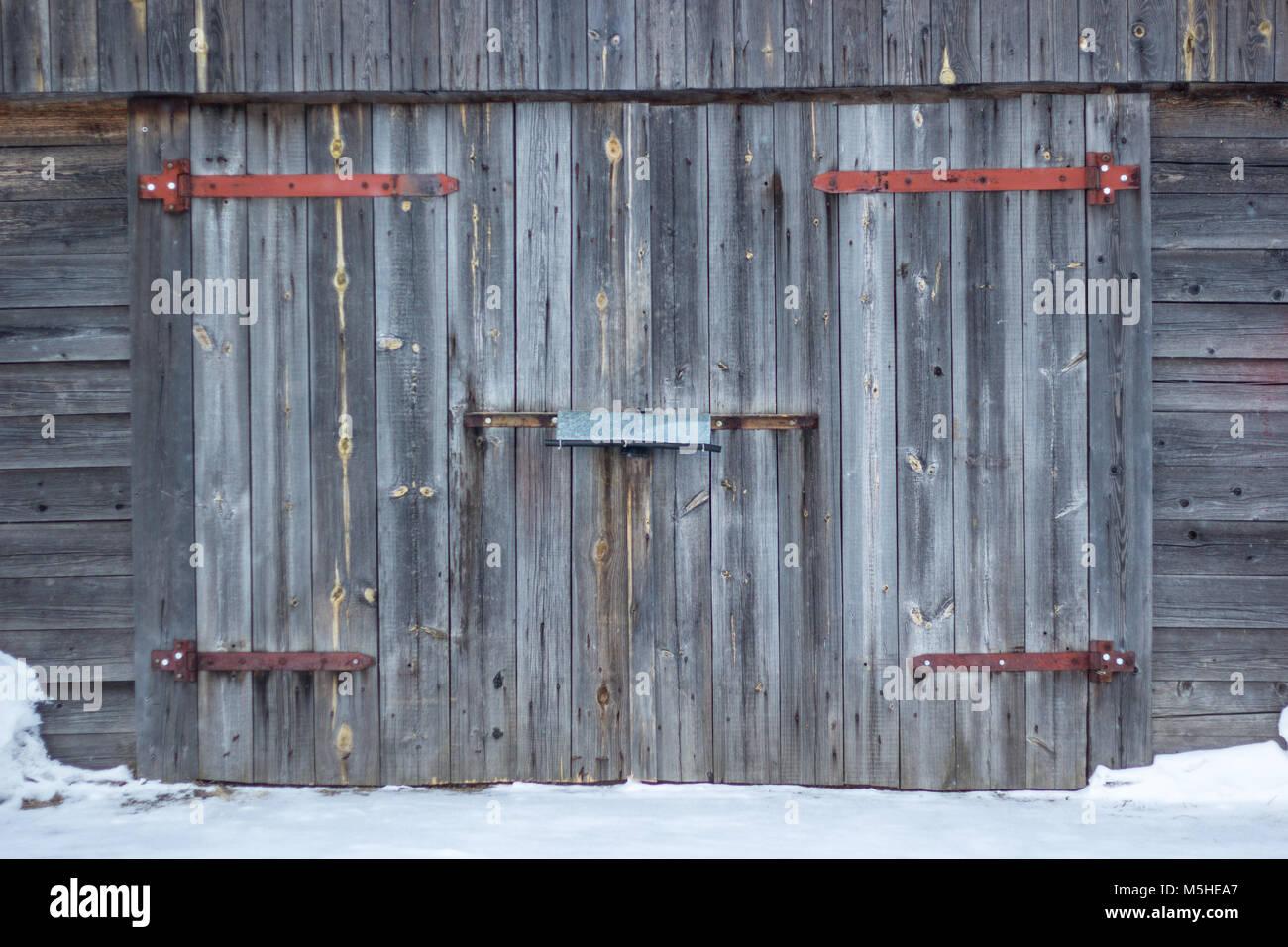 Garage Facade With Old Gray Wooden Gates. Old Garage Door   Stock Image