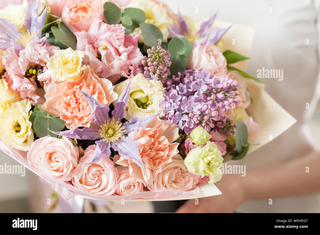 Bouquet of delicate pastel color beautiful luxury bunch of mixed bouquet of delicate pastel color beautiful luxury bunch of mixed flowers in womans hand the work of the florist at a flower shop izmirmasajfo Images