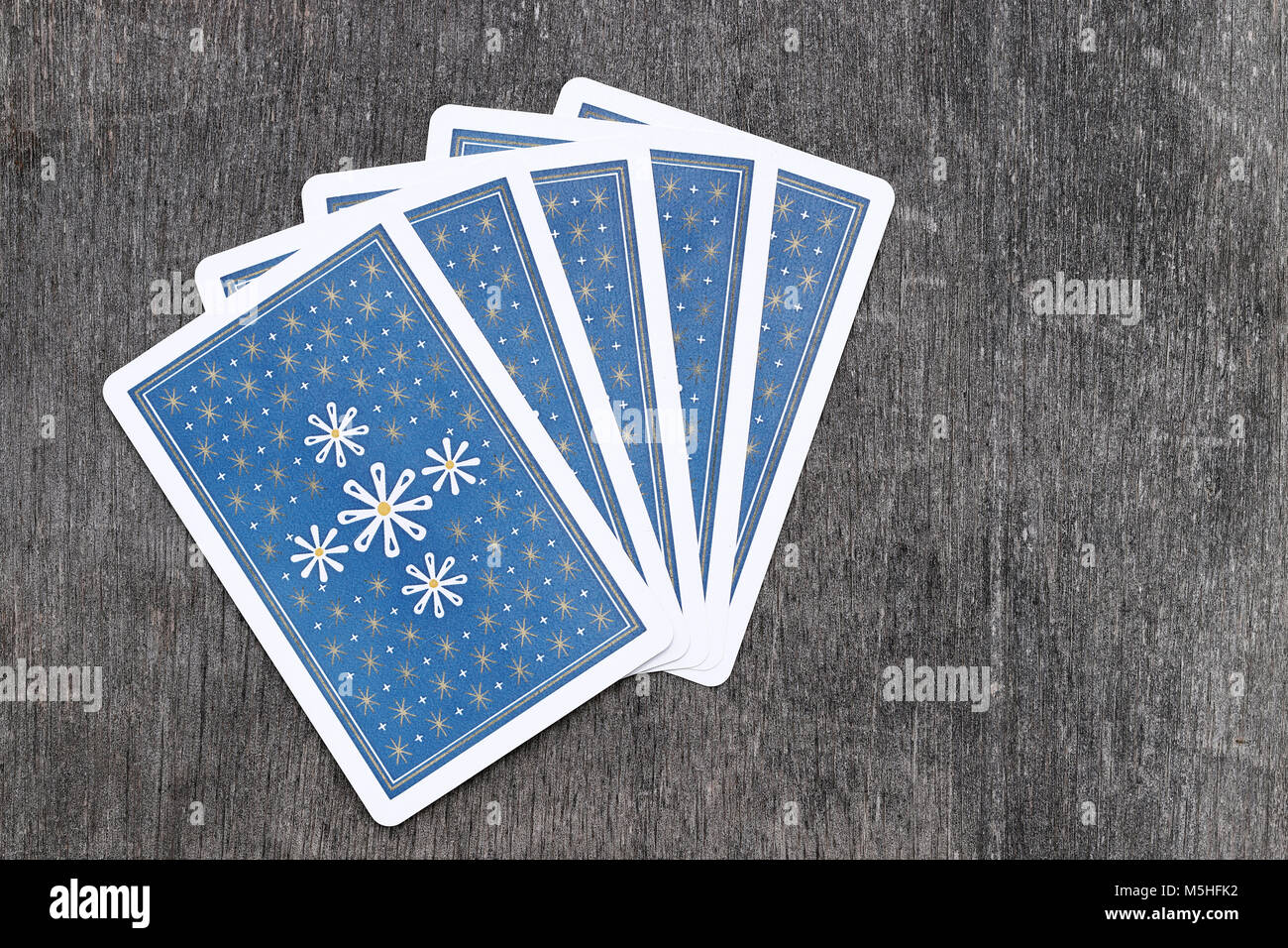 Trump cards back side on grungy wooden table at the studio shot - Stock Image