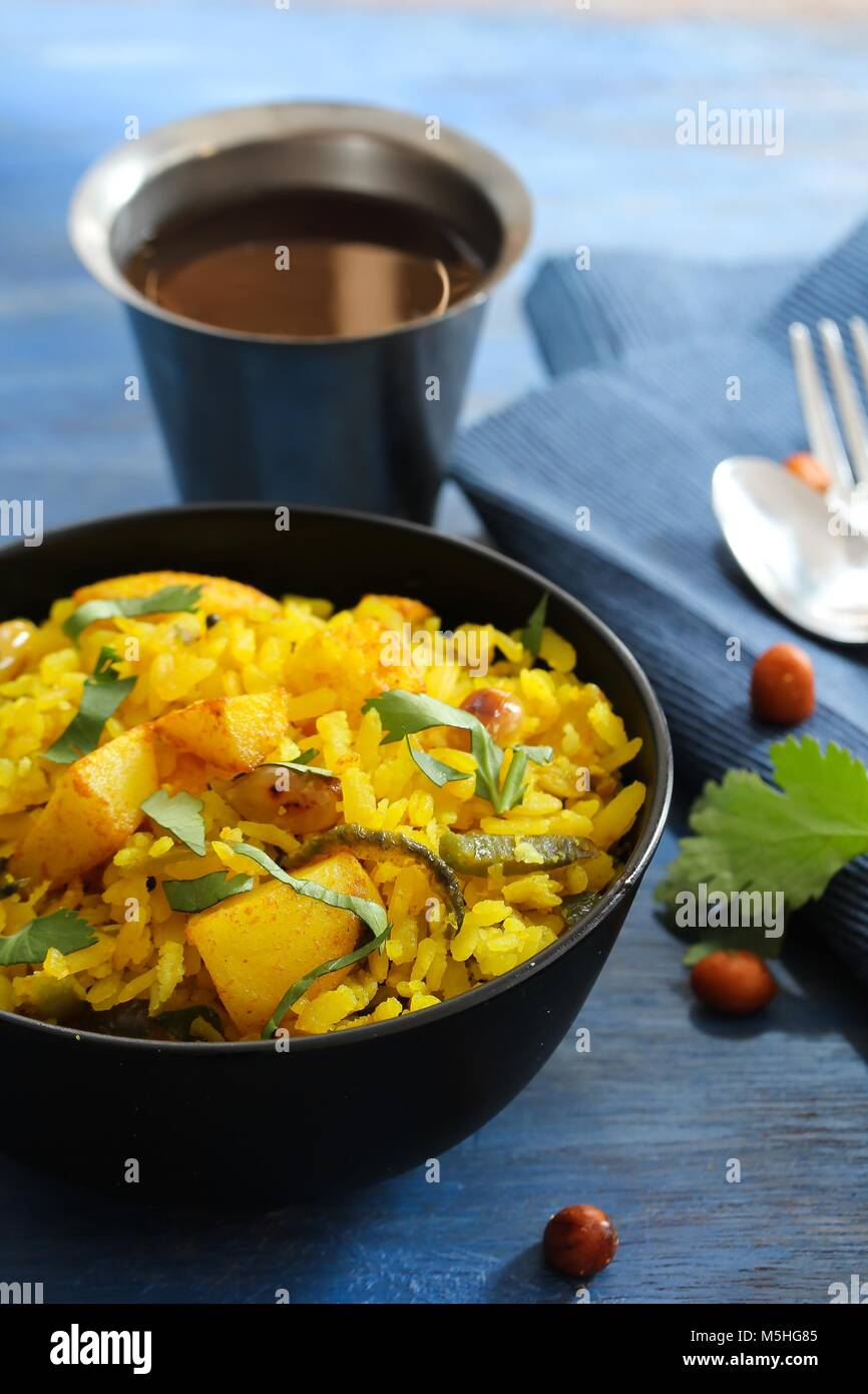 Batata Poha / Indian breakfast with potatoes and flattened rice, selective focus - Stock Image