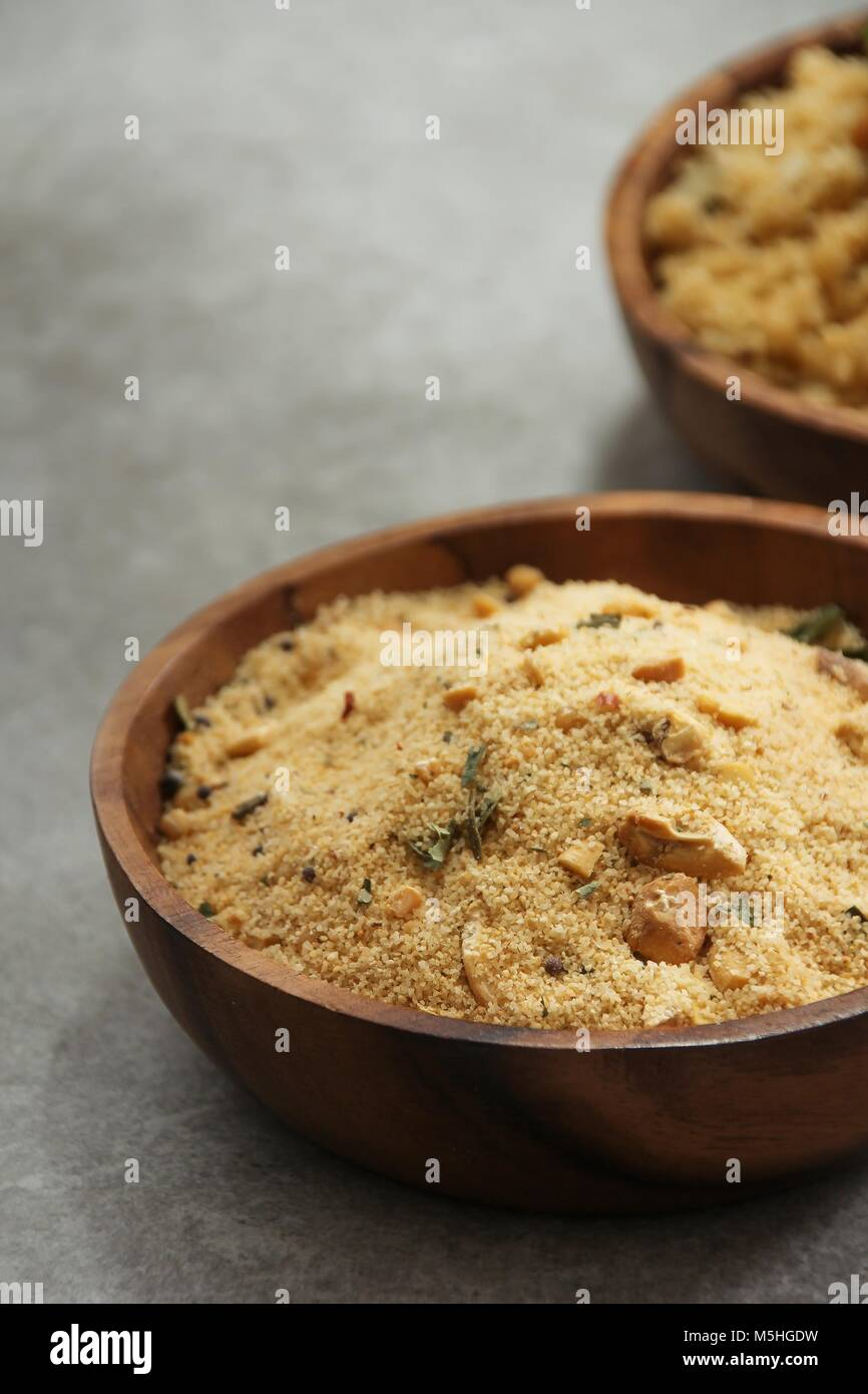 Indian Rava Upma mix in a woden bowl, selective focus - Stock Image