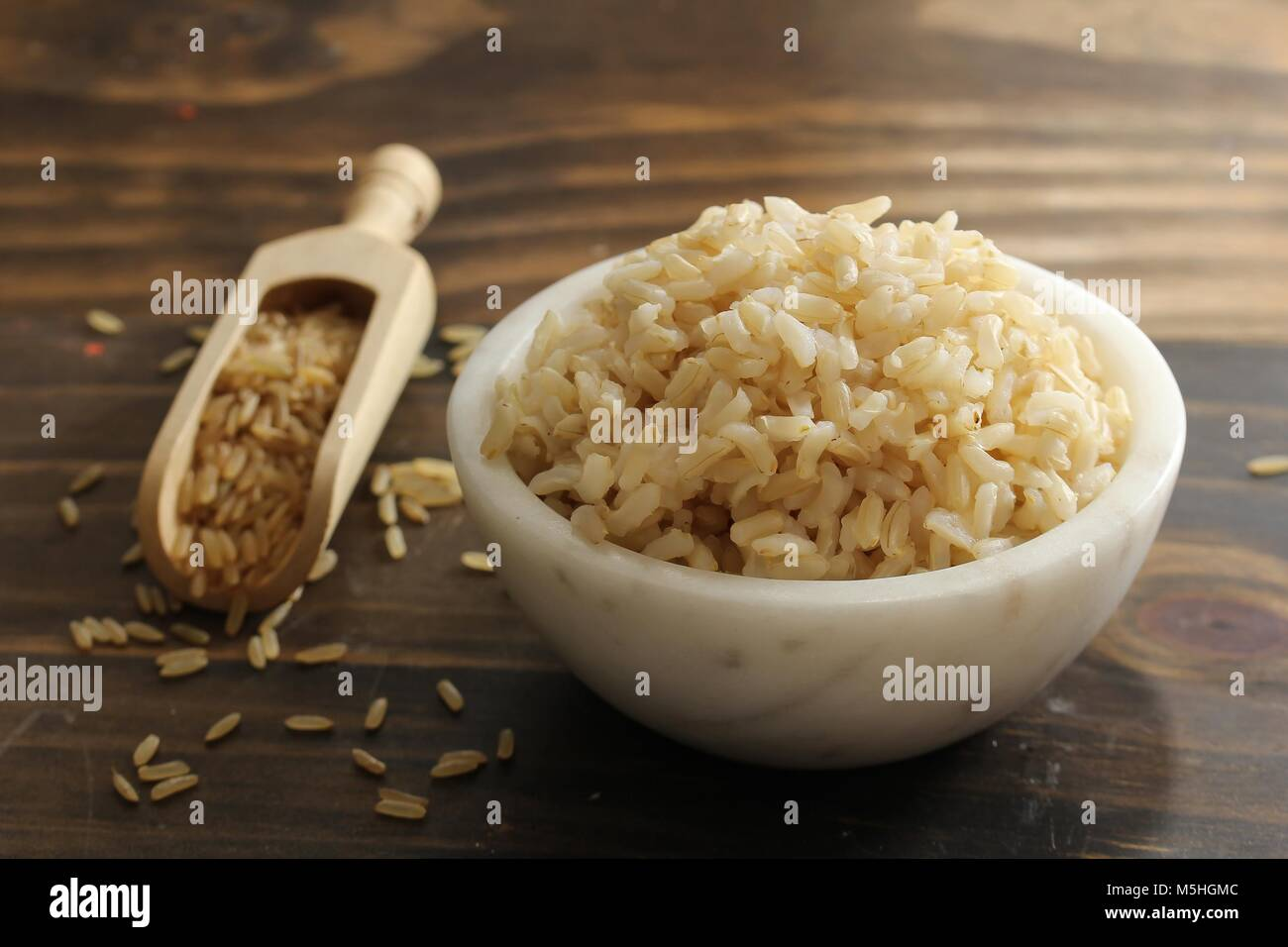 Cooked Whole grain brown rice served in a bowl, selective focus - Stock Image