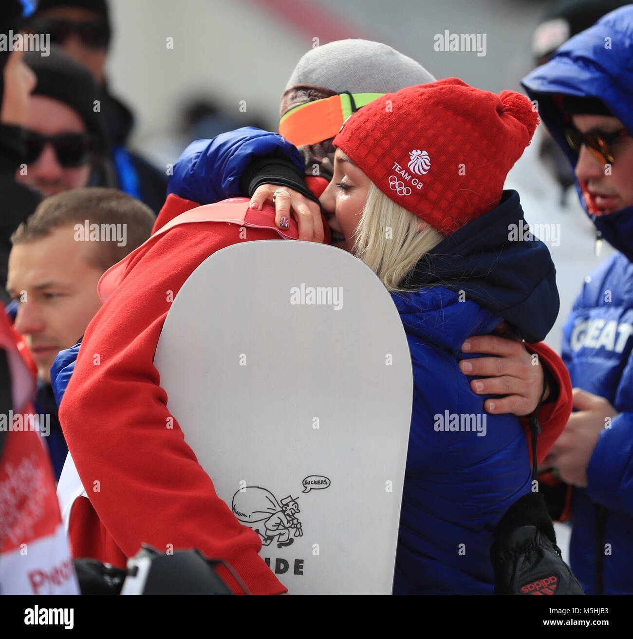 Great Britain's Billy Morgan gets a hug from a tearful Aimee Fuller after he wins bronze in the Men's Snowboarding - Stock Image