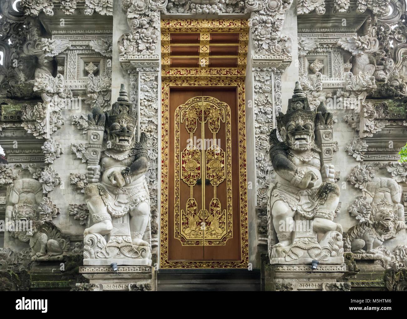 Demons and ornate doors, Puri Kantor, Ubud, Bali - Stock Image