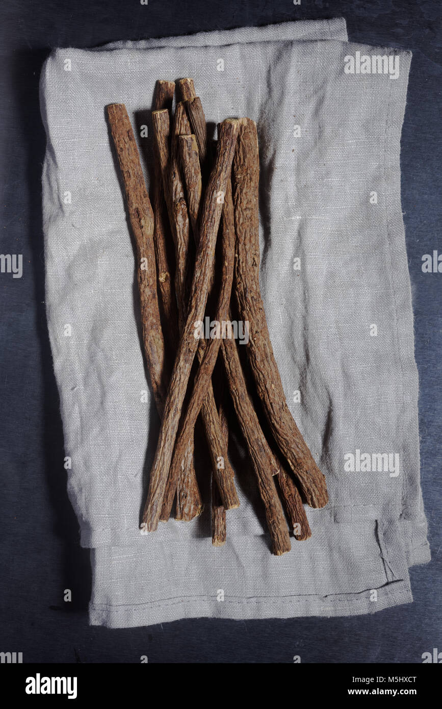 Licorice roots on a kitchen towel - Stock Image