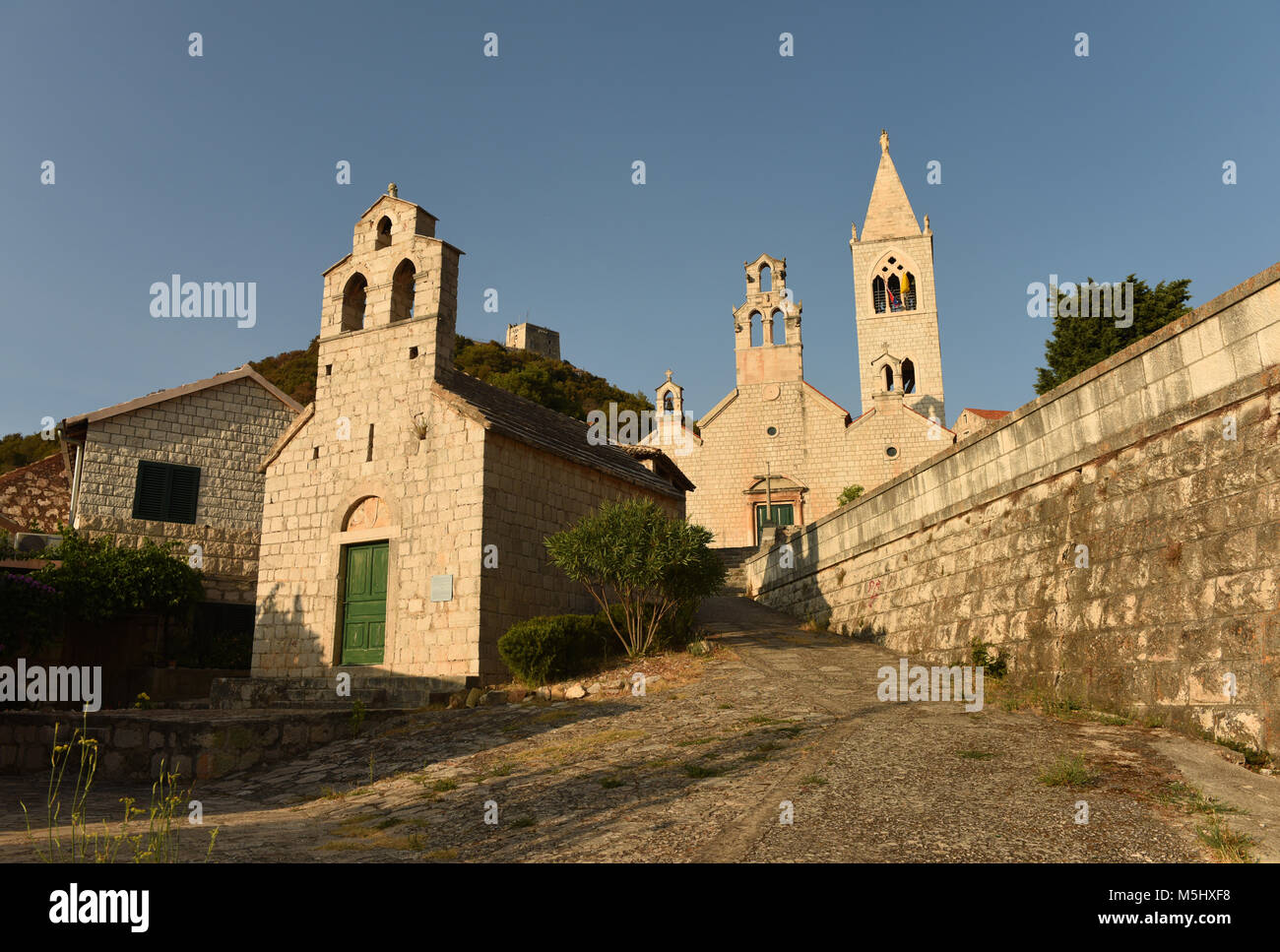 The churches of Saint Mary of grace and of saint Kosmas and Damian in Lastovo town on  island of Lastovo, Croatia - Stock Image