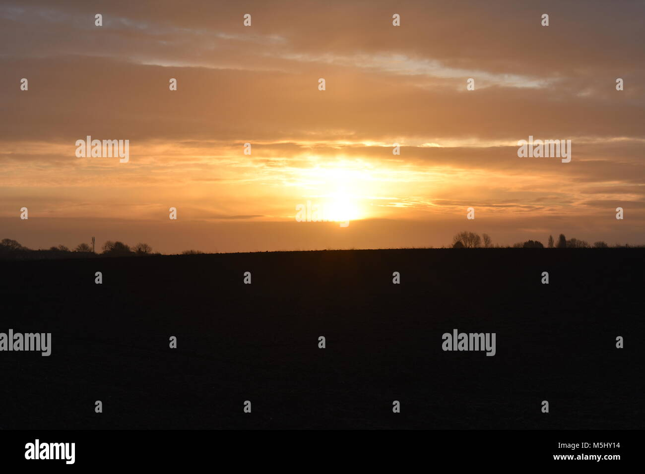 Sun Rise in British country side - Stock Image
