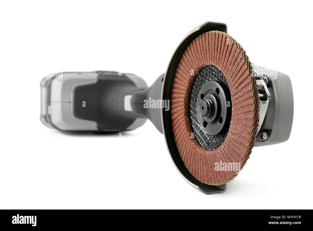 Battery angle grinder isolated on white background. Focus on foreground - Stock Image