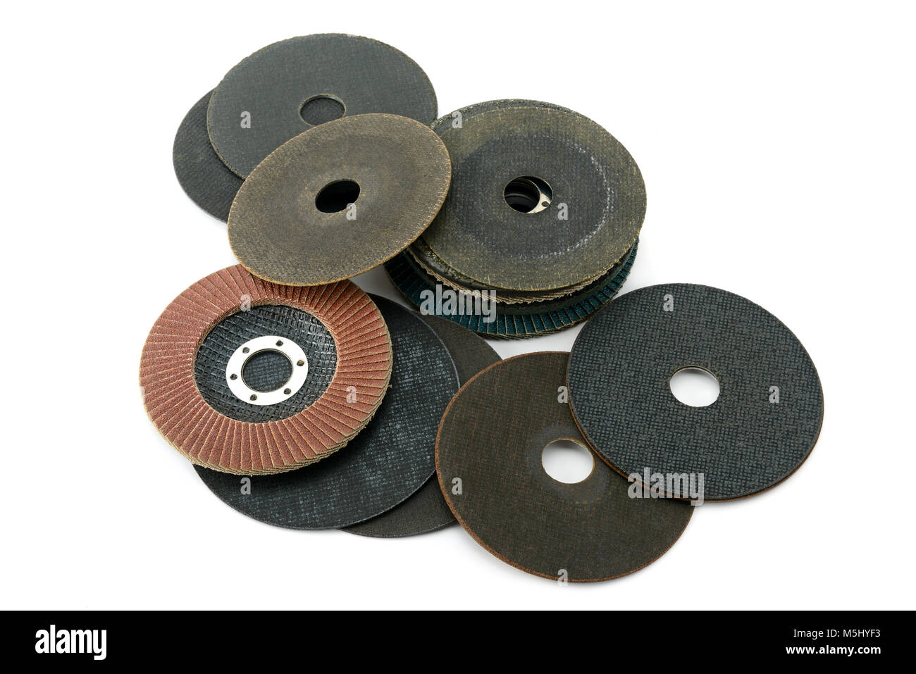 Set cutting discs for angle grinder isolated on white background. Top view. - Stock Image