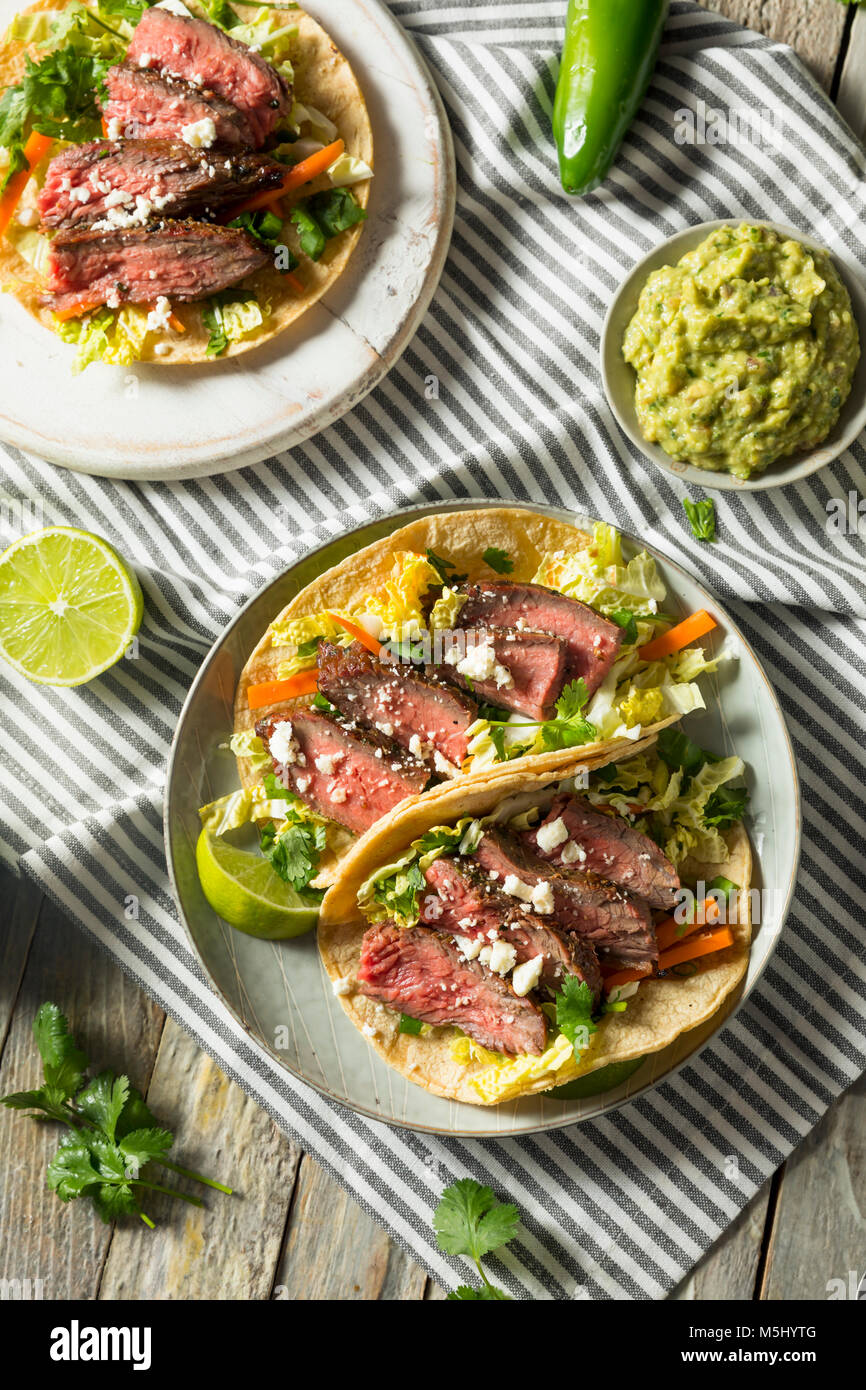 Homemade Korean Steak Tacos with Cabbage Cilantro and Cheese - Stock Image