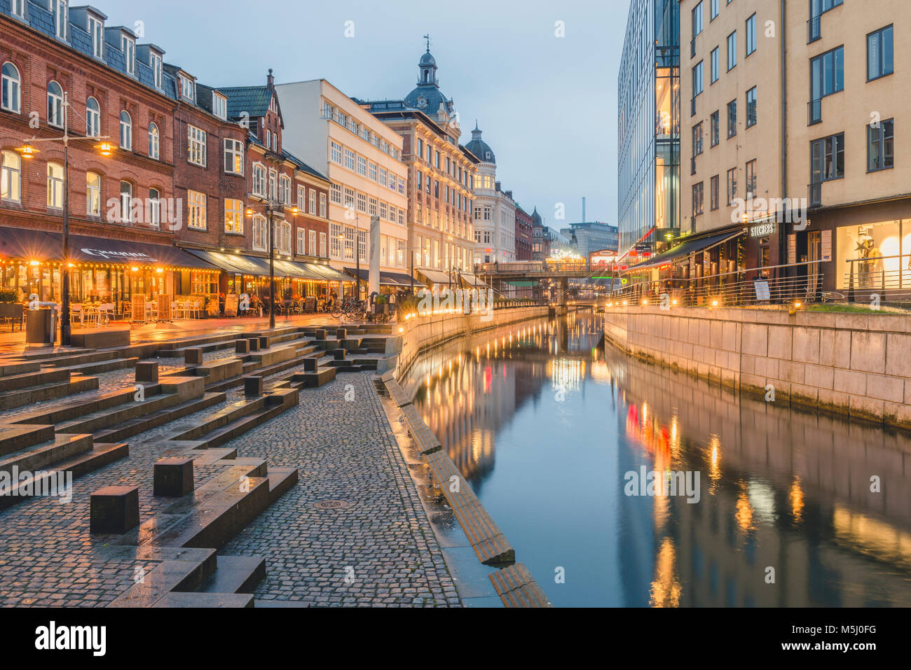 Denmark, Aarhus, view to lighted city with Aarhus River - Stock Image