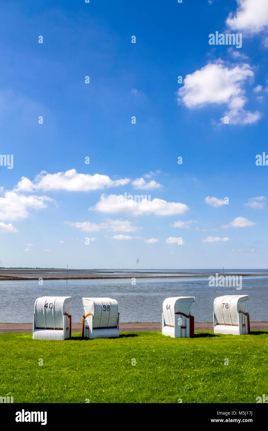 Germany, Schleswig-Holstein, Husum, hooded beach chairs - Stock Image