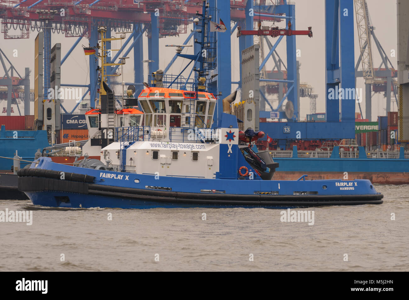 Hamburg, Germany - March 01st, 2014: The tugboat Fairplay X is one of 33 tugboats of the Fairplay line from the - Stock Image