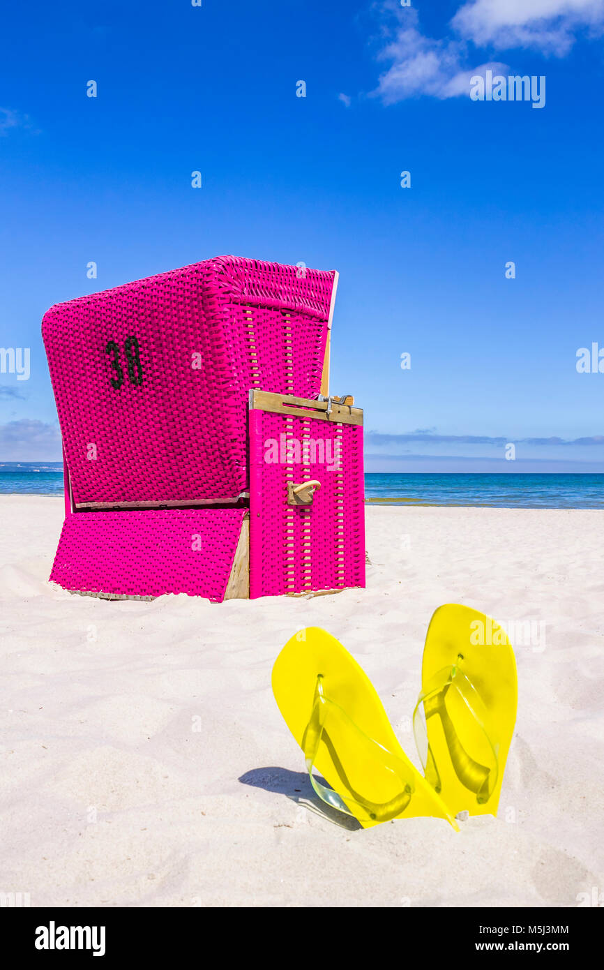 Germany, Mecklenburg-Western Pomerania, Baltic sea seaside resort Binz, Hooded beach chair on the beach - Stock Image