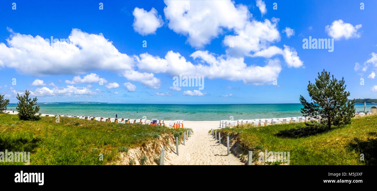 Germany, Mecklenburg-Western Pomerania, Baltic sea seaside resort Binz, Hooded beach chairs on the beach - Stock Image