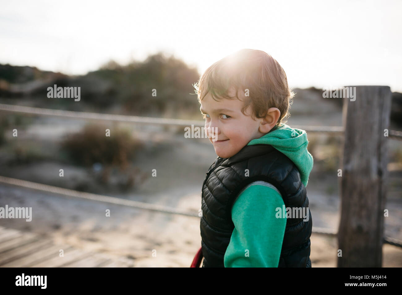 Portrait of a boy grimacing on the beach Stock Photo