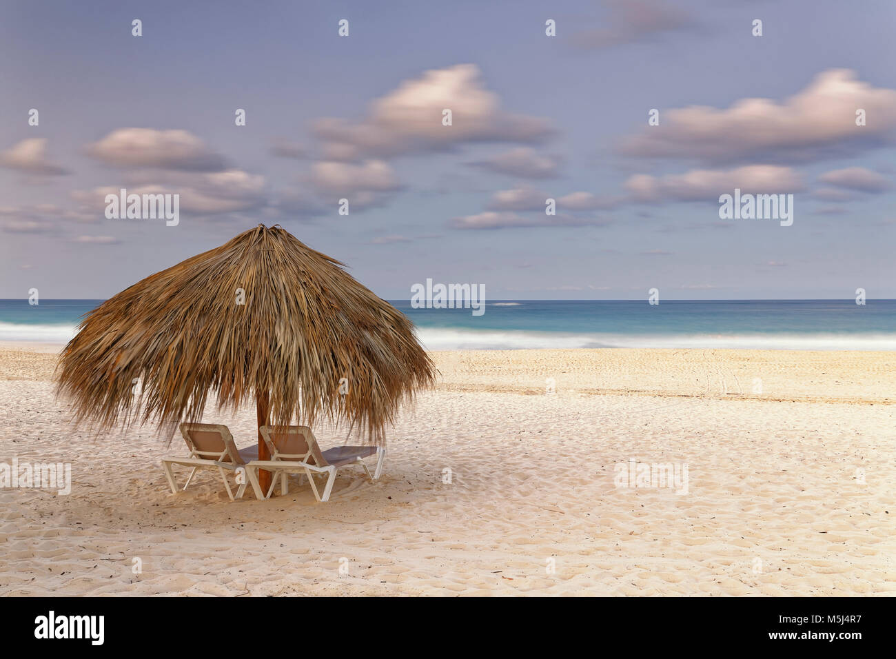 Carribean, Dominican Republic, Punta Cana, Playa Bavaro, beach at sunset Stock Photo
