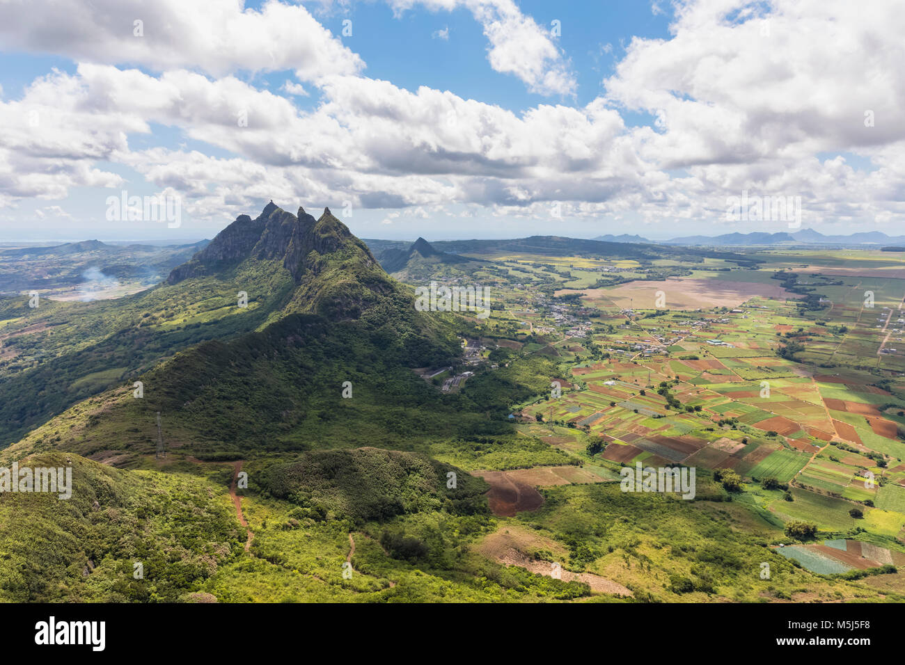 Mauritius, View from Le Pouce Mountain to summits Grand Peak,  Creve Coeur and Pieter Both - Stock Image