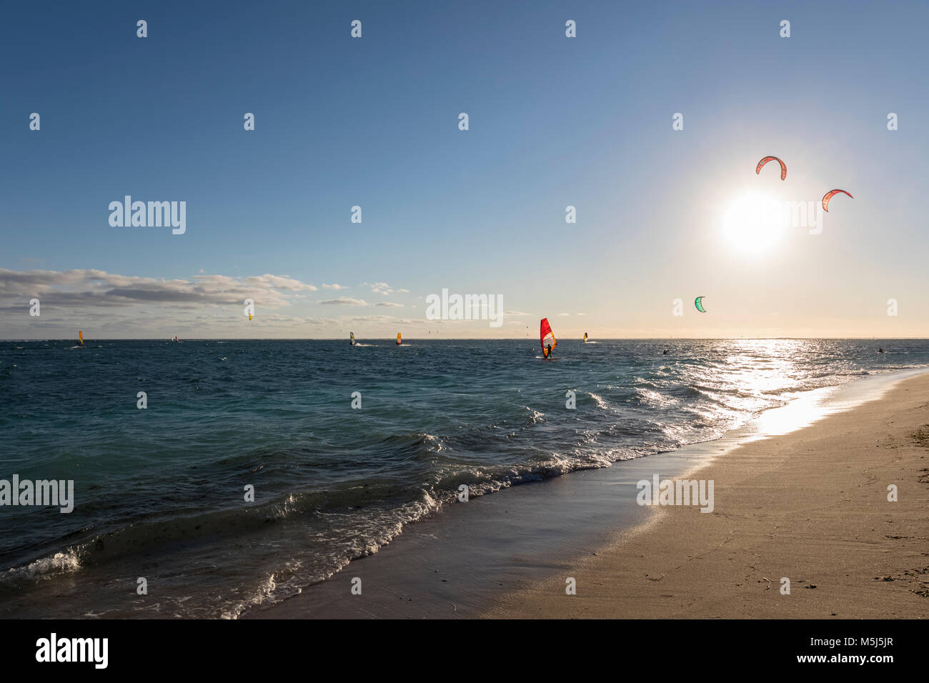 Mauritius, Southwest Coast, beach of Le Morne with kite surfers and sail boarders - Stock Image