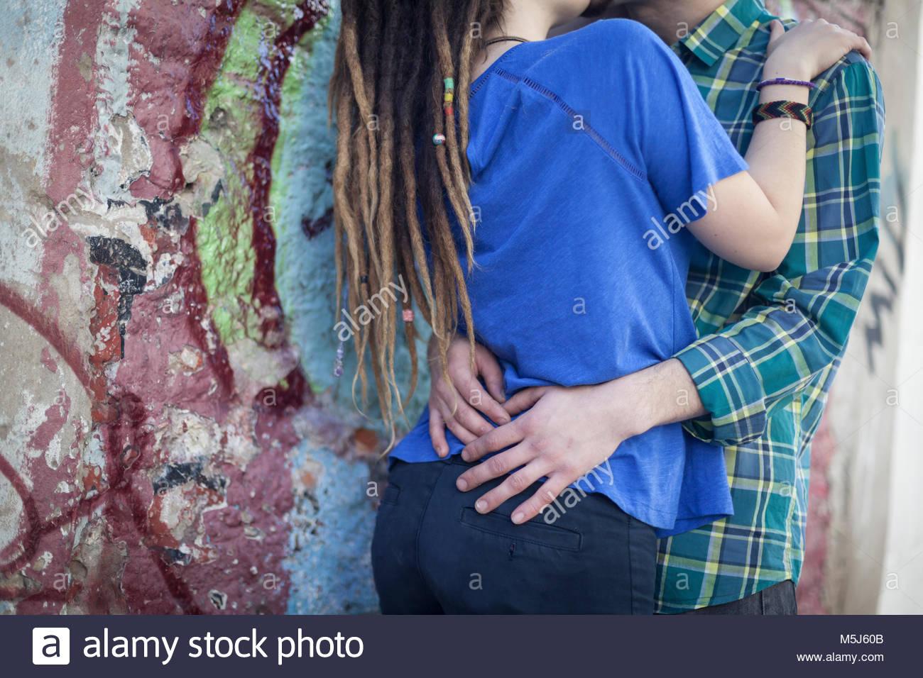 Caucasian couple kissing in park Stock Photo