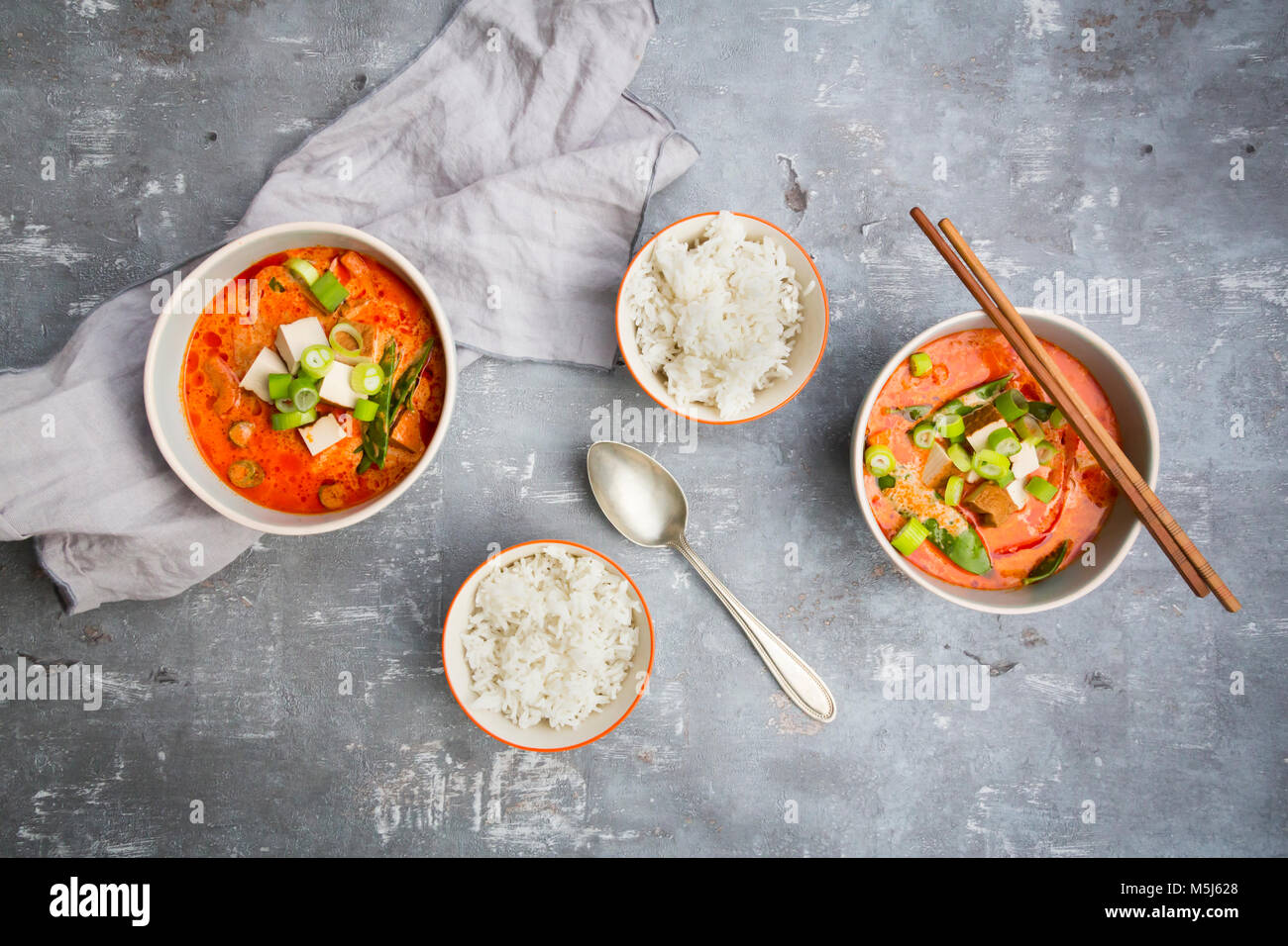 Red curry dish with smoked tofu - Stock Image