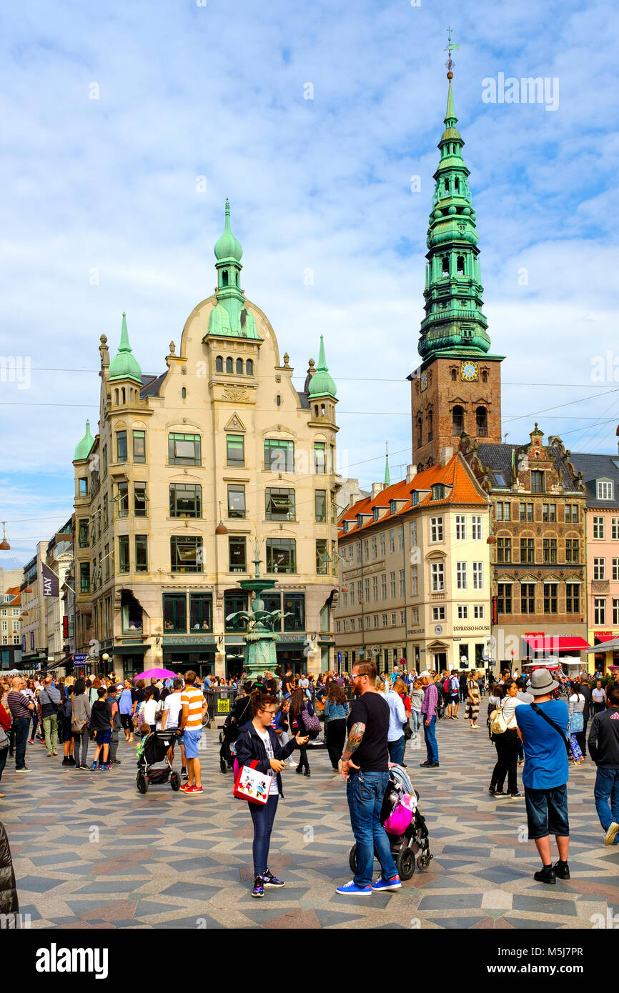 Copenhagen, Zealand region / Denmark - 2017/07/26: Amagertorv square; Stork Fountain and Lutheran St. Nicholas Church - Stock Image