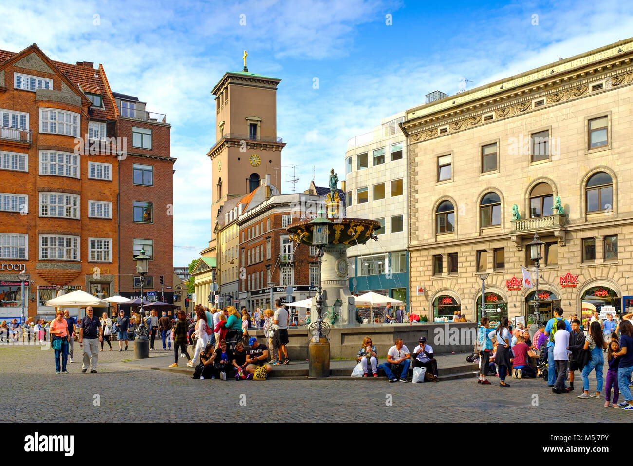 Copenhagen, Zealand region / Denmark - 2017/07/26: Amagertorv square; Stork Fountain and Cathedral Church of Our - Stock Image