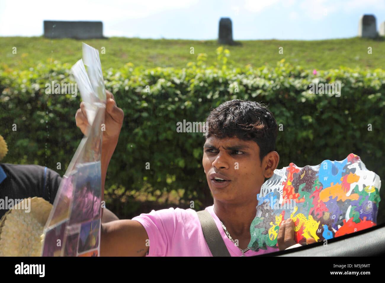 Polonnaruwa North Central Province Sri Lanka Hawker Selling Postcards - Stock Image